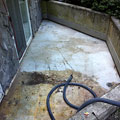A concrete coating will be applied to this old, damaged concrete surface